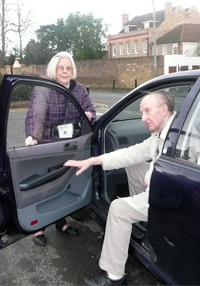 A volunteer driver takes a client to a medical appointment.