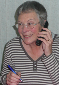 A volunteer Duty Officer takes a call from a Care client.
